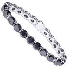49.86 Carat Black Diamond 18 K White Gold Modern line Claw Set Tennis Bracelet