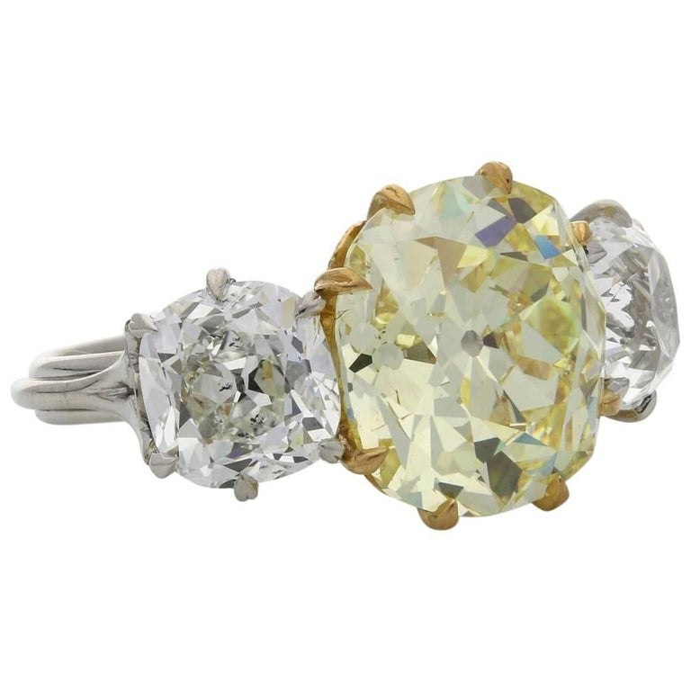 Hancocks Three-Stone Diamond and Fancy Intense Yellow Diamond Ring