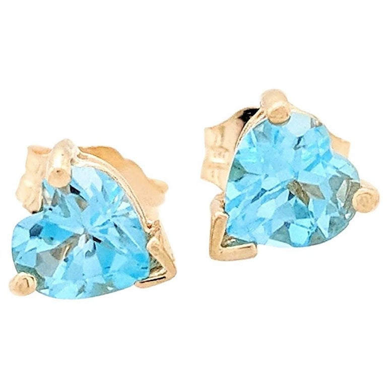 14 Karat Yellow Gold .50 Carat Heart Shaped Blue Topaz Stud Earrings