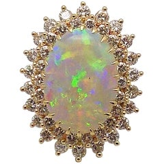 Opal and Diamond Ring in 18 Karat Yellow Gold