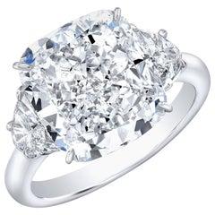 GIA Certified 7.07 Carat J SI1 Cushion Diamond Three-Stone Ring with Half Moons