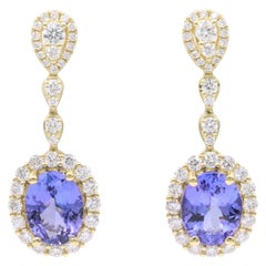 18 Karat Oval Tanzanite Diamond Cluster Dangle Drop Earrings