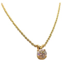 Diamond Pendant and 14 Karat Yellow Gold Rope Chain