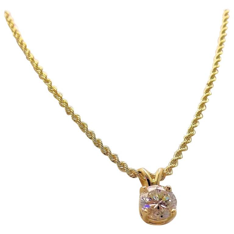 Diamond Pendant and 14 Karat Yellow Gold Rope Chain