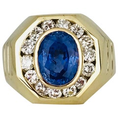 Oval Blue Sapphire, 3.00 Carat Set in Diamond Halo Ring