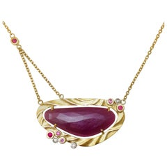 Red Island Pendant Featuring a 15.92 Carat Rose Cut Ruby & 18 Karat Yellow Gold