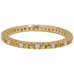 18 Karat Gold Band with 0.41 Carat of Yellow Sapphire and 0.16 Carat of Diamond
