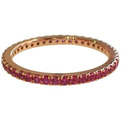 18 Karat Rose Gold Eternity Band with 0.60 Carat of Ruby