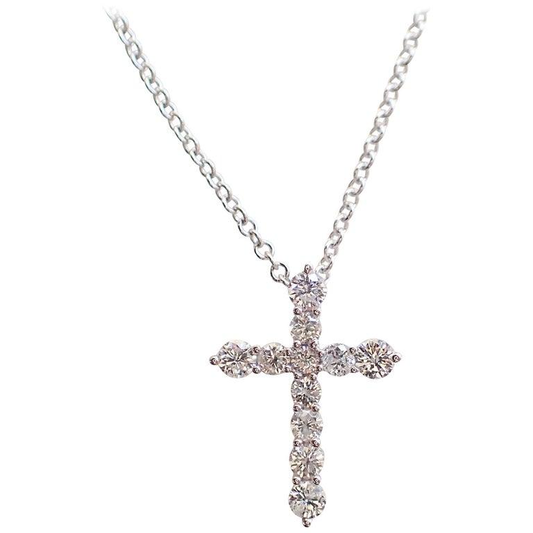 18 Karat White Gold Petite Cross with 0.25 Carat of Diamond Hangs on Chain