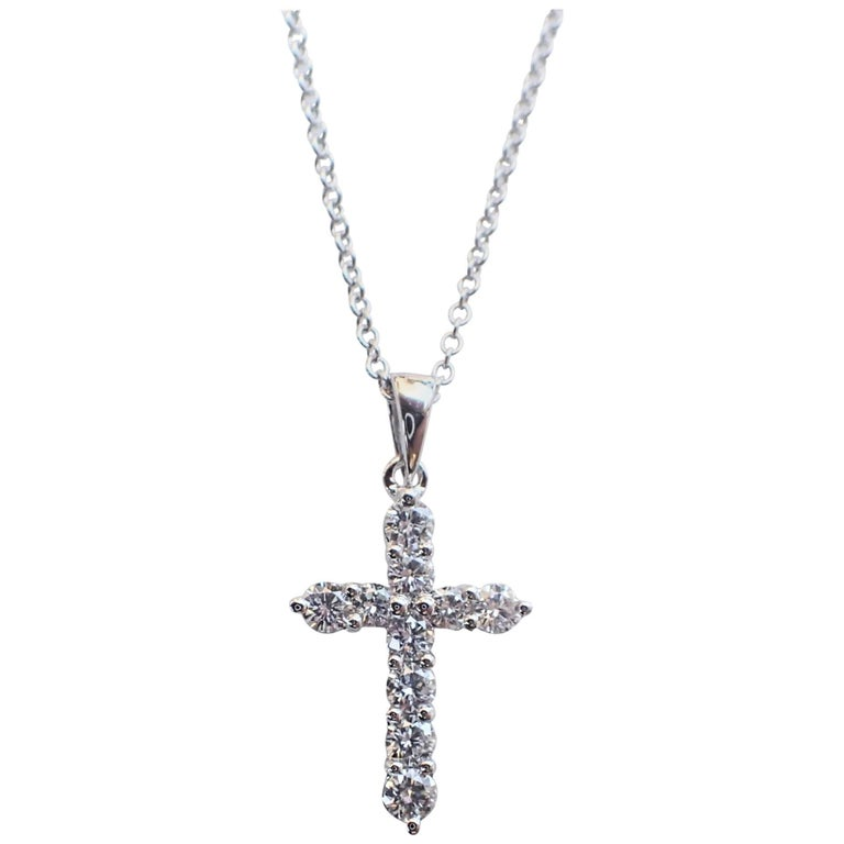 18 Karat White Gold Thin Cross with 0.37 Carat of Diamond Hangs from Chain