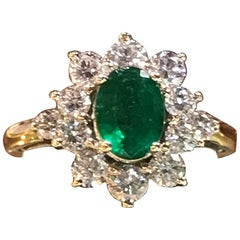 1.56 Oval Cut Emerald with 1.06 Carat of Diamond Cocktail Ring