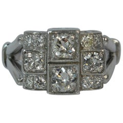 Art Deco VS 1.40 Carat Diamond and Platinum Panel Cluster Ring