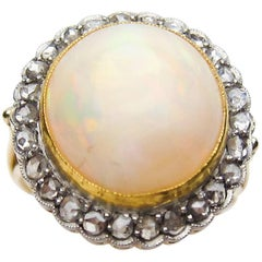 Edwardian 8 Carat White Opal Cabochon and Rose-Cut Diamond 14KT Gold Halo Ring