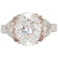 Certified Platinum and Rose Gold Oval Diamond Engagement Ring 5.56 Carat