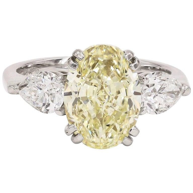 GIA Certified Natural Light Yellow 3.82 Carat Oval Chardonnay Diamond® Ring