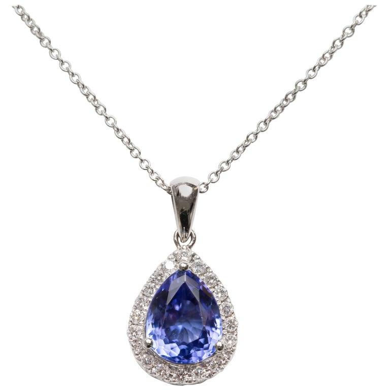 1.26CT Pear Shape Tanzanite 0.35 CT Pave Set 18KT Gold Diamond Pendant Necklace