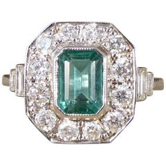 Emerald and Diamond Cluster 18 Carat White Gold Engagement Ring