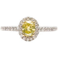 GIA 0.87 Carat Yellow Cushion Diamond 18 Karat White Gold Halo Engagement Ring