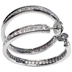 Pair of 18 Karat White Gold Cartier Diamond Hoop Earrings