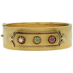 Yellow Gold Wide Ladies Bangle Bracelet with Ruby, Emerald and Diamond