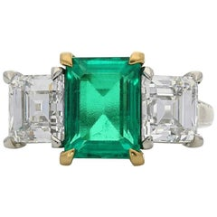Hancocks Colombian Emerald and Carre Cut Diamond Three-Stone Ring