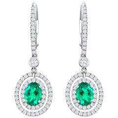 Oval Cut Green Emerald and Diamond Halo Dangle Earrings
