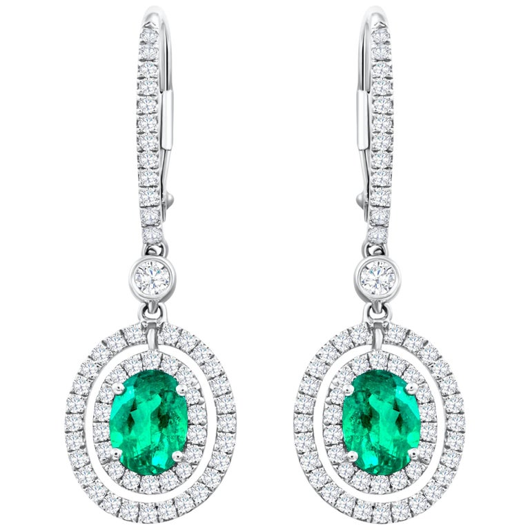 Oval Cut Green Emerald and Diamond Halo Dangle Earrings For Sale