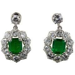 Spectacular Vintage 2.00 Carat Emerald 4.50 Carat Diamond Platinum Earrings