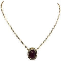 Oval Ruby Cabochon and Diamond Pendant Necklace in 18 Karat Yellow Gold