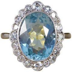 Edwardian 3 Carat Aquamarine, Diamond, Gold and Platinum Cluster Engagement Ring