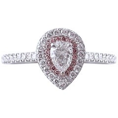 Platinum Ring with a 0.46 Carat Pear Shape Diamond & Natural Light Pink Diamond