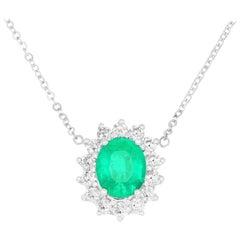 1.02 Carat Oval Cut Emerald and 0.47 Carat White Diamond Necklace
