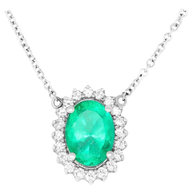 2.86 Carat Oval Cut Emerald and 0.43 Carat White Diamond Pendant