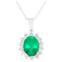 2.08 Carat Oval Cut Emerald and 0.53 Carat White Diamond Pendant