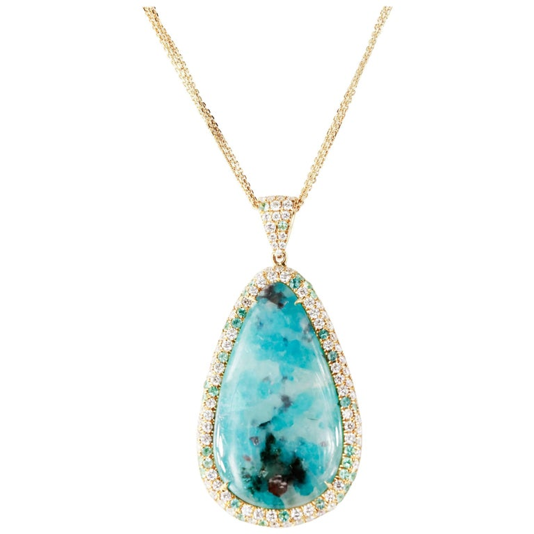 15.43 Carat Paraiba Tourmaline Pearshape Pendant with Diamond Halo in 18kyg