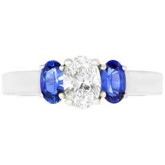 0.50 Carat White Diamond and 0.61 Carat Blue Sapphire 3 Stone Engagement Ring
