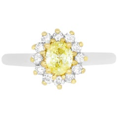 0.56 Carat Oval Yellow Diamond and 0.39 Carat White Diamond Ring