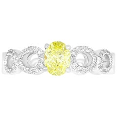0.71 Carat Oval Cut Yellow Diamond Engagement Ring
