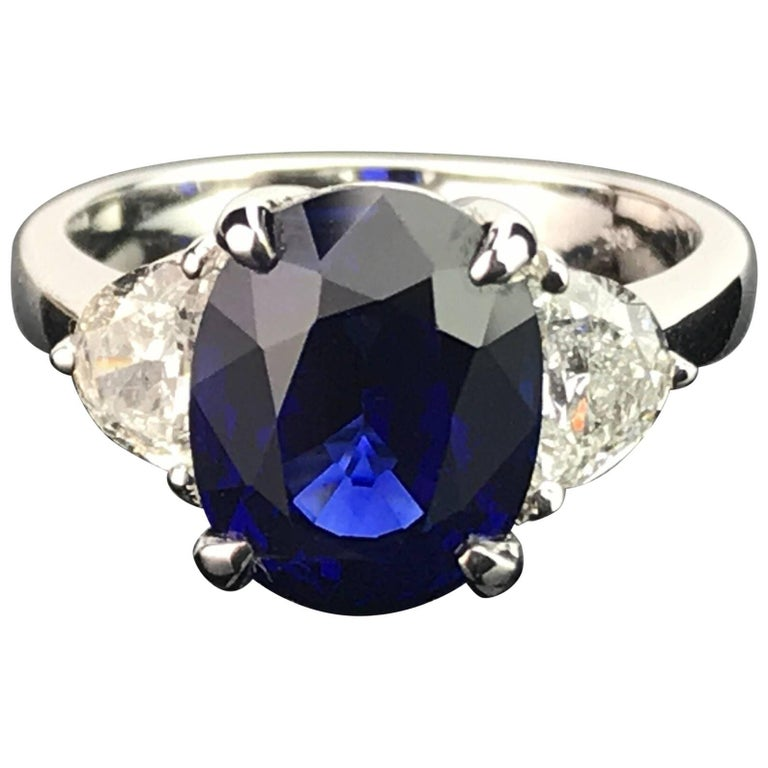 Certified 5.06 Carat Vivid Blue Sapphire and Diamond Three-Stone Ring For Sale