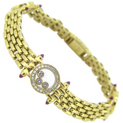 Chopard Happy Diamond and Cabochon Ruby Yellow Gold Bangle Bracelet