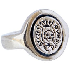 """Secret Doors"" Crest Signet Ring with Skull in Bronze"