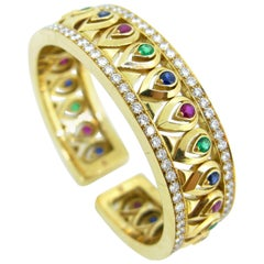 "Cartier ""Tanjore"" Diamond Emerald Ruby Sapphire Yellow Gold Bangle Bracelet"
