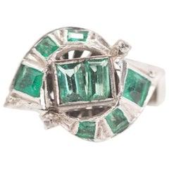 1920s 0.75 Carat Columbian Emerald and 18 Karat White Gold Bypass Ring