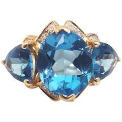14 Karat Beautiful Blue Topaz and Diamond Ring
