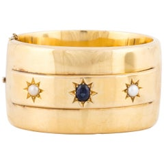 14 Karat Wide Bangle with Sapphire Pearls