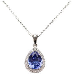 1.26 Carat Pear Shaped Tanzanite 0.30 Carat Diamond 18 Karat Gold Chain Pendant