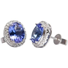3.61 Carat Oval Shaped Tanzanite 0.35 CT White Diamond 18 KT Gold Stud Earrings