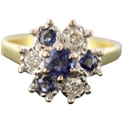 Vintage 18 Karat Yellow Gold Ladies Ring with Blue Sapphire and Diamonds