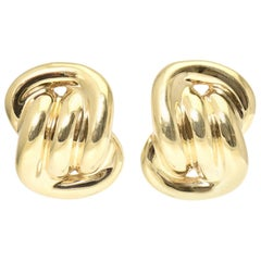 Large Three Dimensional Gold Intertwined Link Knot Clip Earrings
