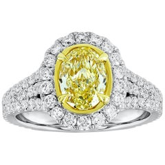 GIA Certified Yellow Oval Cut Diamond Halo Engagement Ring